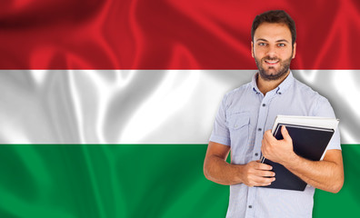 Male student of languages ​​on Hungarian flag