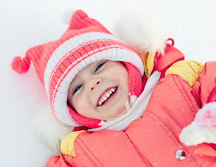 Beautiful happy kid in the red jacket