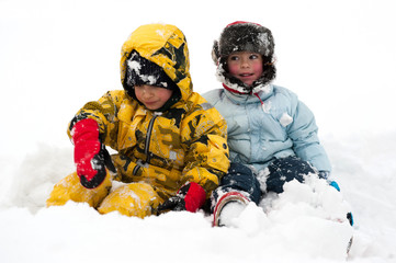 Two friends playing in the snow.