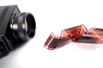 Old camera and film strip, movie production