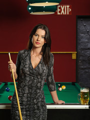 Beautiful brunette at a pool table