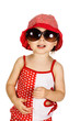 kid in the red hat and sunglasses