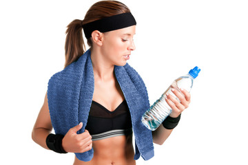Woman Looking at a Bottle of Water