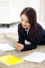 Yong pretty Asian student studying