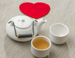 Valentine's day surprise for couple. Romantic tea set with red h