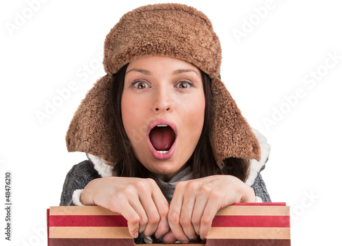Winter woman posing at white background with shopping bag and op