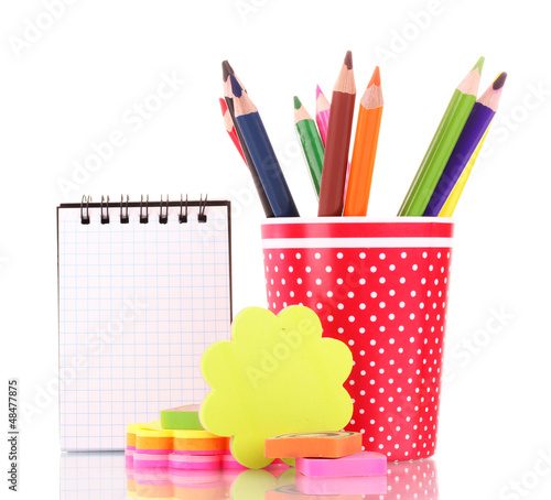 red glass with colorful pencils and stationery isolated on