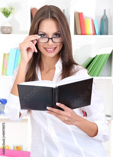 young business woman with notebook at office