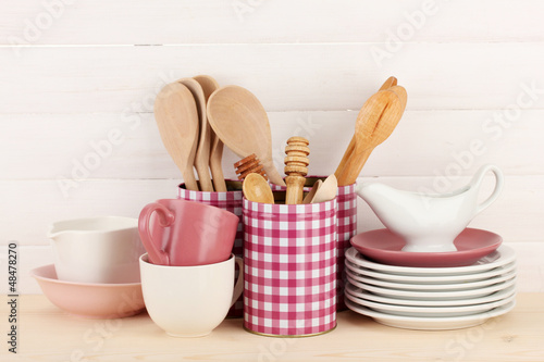 Cups, bowls nd other utensils in metal containers isolated