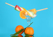 Two fruit juice ice in vase on blue background