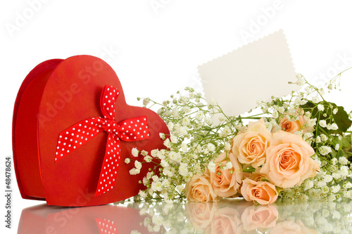 Giftbox and flowers isolated on white
