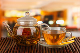 Fototapety Exotic green tea with flowers in glass teapot
