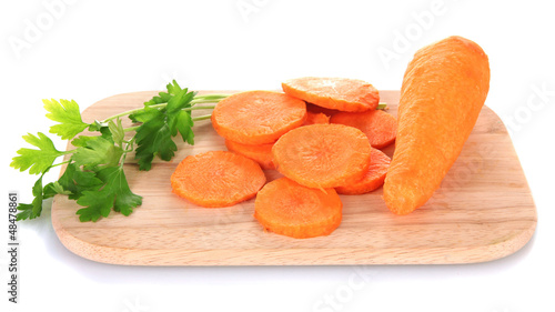 carrots on cutting board isolated on white