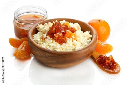 cottage cheese in bowl with homemade tangerine jam, isolated
