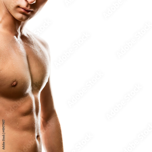 Naked man's chest on white background