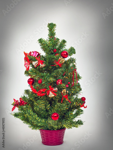 Beautiful Christmas tree with colorful bright bauble hanging