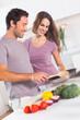 Couple preparing food at the stove