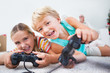 Siblings having fun playing video games
