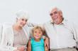 Grandson sitting with grandparents