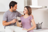Couple toasting with a glass of wine