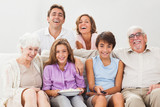 Multi-generation family on couch watching tv