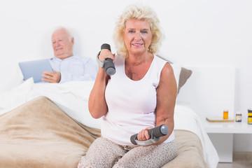 Elderly woman exercising with hand weights
