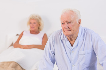 Unsmiling old couple