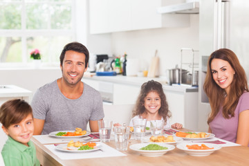 Smiling family having dinner