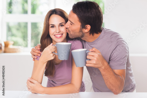 Man kissing his girlfriend