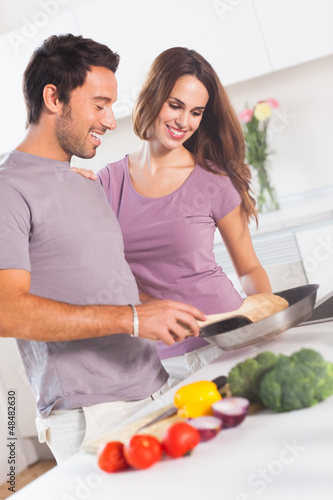 Couple preparing food at the stove