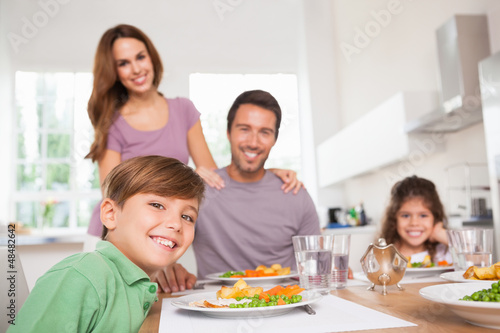 Family looking at the camera at dinner time