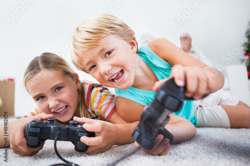 Siblings having fun playing video games