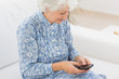 Elderly cheerful woman using a smartphone
