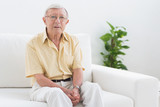 Elderly man looking at camera