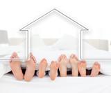 Feet family in the duvet with house illustration