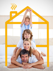 Family having fun with yellow drawing house