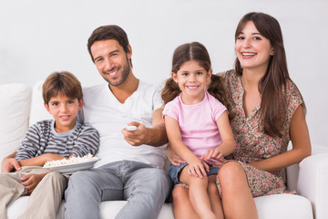 Smiling family watching the television