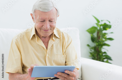 Elderly man using a digital tablet