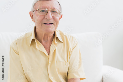 Cheerful elderly man looking at camera
