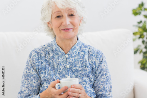 Elderly smiling woman looking at camera
