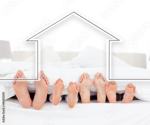 Feet family in the duvet with house illustration