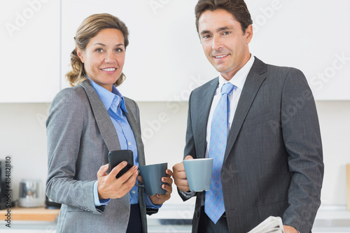 Power couple having coffee before work