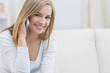 Portrait of casual young woman using mobile phone at home