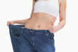 Midsection of woman wearing old pants after losing weight and ge