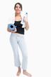 Portrait of woman in sportswear holding water bottle and mat