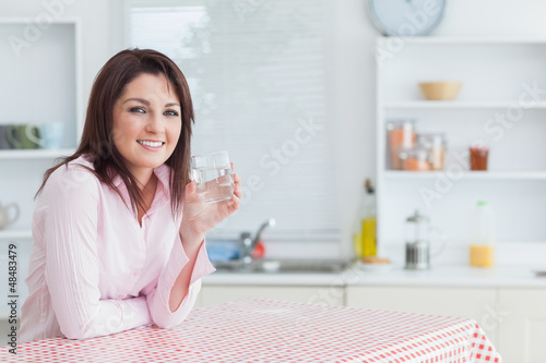 Young woman with glass of water