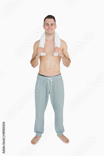 Portrait of happy man holding towel around neck