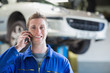 Car mechanic using mobile phone