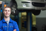 Confident male auto mechanic
