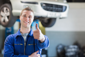 Male mechanic giving thumbs up